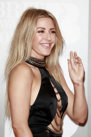 Ellie Goulding attended the Brit Awards wearing her hair in a long layered cut.