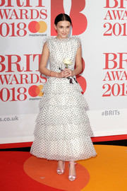 Millie Bobby Brown looked downright darling in a tiered polka-dot dress by Rodarte at the 2018 Brit Awards.