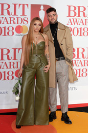 Jesy Nelson was a '70s babe in this green bell-bottom leather jumpsuit at the 2018 Brit Awards.