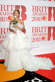 Rita Ora floated onto the Brit Awards red carpet in a feather-festooned strapless gown by Ralph & Russo Couture.