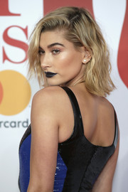 For her beauty look, Hailey Baldwin went the vampy route with a dark lip.