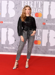 Natalie Dormer teamed her jeans with a fitted black leather top.