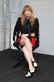 Natasha Lyonne added a dash of color with a red mini skirt.