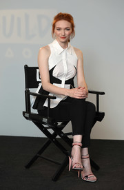 Eleanor Tomlinson pulled her flawless look together with a pair of multicolored striped sandals by Christian Louboutin.