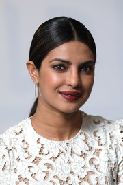 Priyanka Chopra kept it minimal with this tight, center-parted ponytail at the Build LDN event.