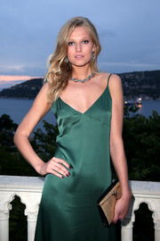 Toni Garrn's metallic gold clutch and emerald slip dress at the Bulgari brand event were a very elegant pairing.