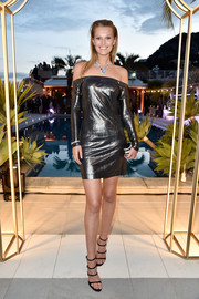Toni Garrn went for edgy glamour in a gunmetal off-the-shoulder mini dress during the Bulgari brand event.