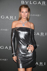 Toni Garrn paired a monochrome chain-strap bag with a metallic off-the-shoulder mini for the Bulgari brand event.