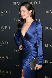 Emmy Rossum was perfectly styled at the Decades of Glamour Oscar party with this black Bulgari exotic-skin clutch and blue faux-wrap dress combo.