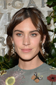 Alexa Chung swept her locks back into a romantic loose updo for the Bvlgari & Rome: Eternal Inspiration opening night.