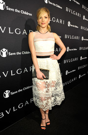 Katheryn Winnick attended the BVLGARI And Save The Children Pre-Oscar Event in a lovely lace dress with a cute sheer skirt.