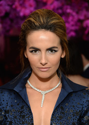 Camilla Belle complemented her plunging dress with a statement-making Bulgari Serpenti necklace.