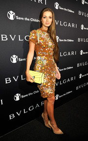 Lara Leito chose a stunning beaded dress in playful colors for the BVLGARI And Save The Children Pre-Oscar Event.