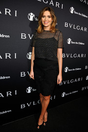 Carly Steele opted for a simple black dress with a sheer overlay at the BVLGARI And Save The Children Pre-Oscar Event.