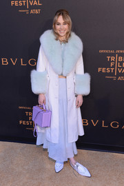 Suki Waterhouse made a grand arrival in a shearling-trimmed leather coat by Saks Potts at the BVLGARI world premiere screening during Tribeca.