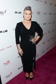 Kelly Osbourne cut a curvy figure in this form-fitting LBD at the Babes for Boobs Bachelor Auction.