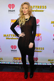 Iggy Azalea cut a shapely figure in a tight-fitting black and red sweater dress during Hot 99.5's Jingle Ball.
