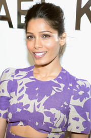 Freida Pinto styled her locks into a simple yet lovely classic bun for the Michael Kors fashion show.