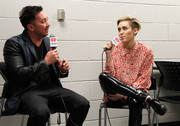 Miley Cyrus was menswear-chic in an oversized button-down shirt by Chanel at the Jingle Ball in Atlanta.