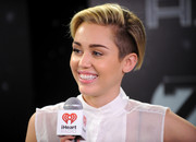 Miley Cyrus fixed her short hair into a gelled side-parted style for Jingle Ball.
