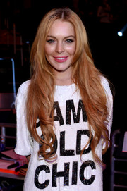Lindsay Lohan left her ultra-long hair loose with soft waves during Jingle Ball.