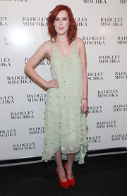 Rumer Willis added a splash of color to her minty chiffon dress with fire engine red suede Tribtoo platforms.