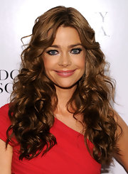 Denise Richards was full of glamorous curls for the Badgley Mischka show. Long cascading ringlets framed her glowing face.