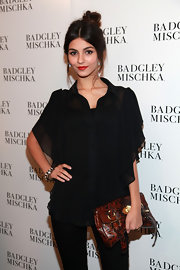 Victoria Justice's exotic-skin buckled clutch was a nice contrast to her all-black outfit at the Badgley Mischka Spring 2012 fashion show.