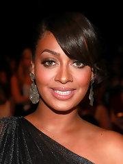 La La Anthony attended the Badgley Mischka fashion show wearing a modern pair of dangle decorative earrings.