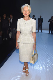 Helen Mirren looked very refined in a belted tweed peplum top by Badgley Mischka while attending the brand's fashion show.