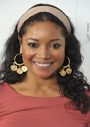 Tamala Jones paired her golden decorative earrings with long curls at the store opening of Badgley Mischka.