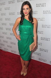 Briana dons a one-shoulder shimmering emerald cocktail dress at the Badgley Mischka store launch.