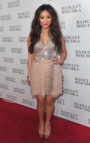 Brenda Song balanced her sparkly red carpet dress with nude platform peep toes.