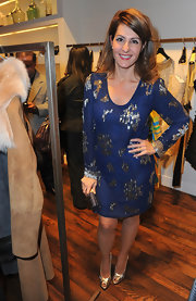 Nia Vardalos played up the gold beading of her long-sleeved navy dress with metallic gold peep toes.