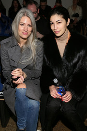 Caroline Issa sported red nail polish for a pop of color to her black outfit at the Baja East Fall 2015 show.