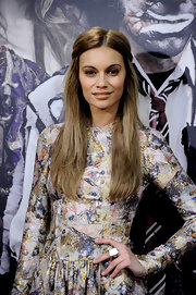 Norma Ruiz showed off her polished long tresses which were elegantly pulled up in a half up hairstyle.