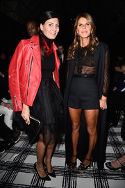 Anna dello Russo layered a floor-length, sleeveless Balenciaga coat over a sheer blouse for the label's fashion show.