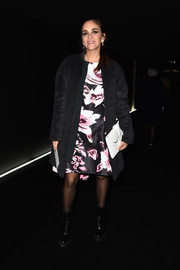 Laure de Broglie arrived for the Balenciaga fashion show wearing a boxy black wool coat over a floral dress.