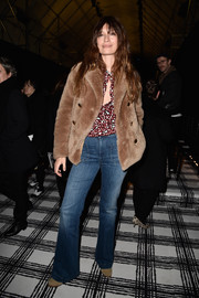 Caroline De Maigret kept cozy with a cute teddy bear coat during the Balenciaga fashion show.