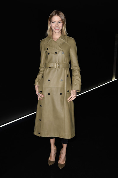 Elena Perminova was classic and edgy in an olive-green leather trenchcoat by Balenciaga during the label's fashion show.