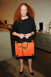 Grace Coddington attended the Fashion's Night Out party wearing black pointed toe flats embellished with a bow.