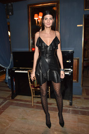 Giovanna Battaglia went for a flirty vibe in a ruffled black leather dress by Balmain during the label's aftershow dinner.