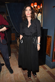 Mademoiselle Agnes kept it simple in a black button-down during the Balmain aftershow dinner.