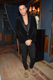 Olivier Rousteing completed his outfit with a pair of old suede boots.