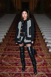 Aimee Song added a heavy dose of edge with a pair of chain-adorned thigh-high boots, also by Balmain.