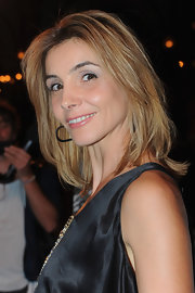 At the Balmain spring/summer 2012 fashion show Clotilde Courau wore her chic, layered bob with a center part and a little volume. To create her look add a product like Fekkai Coiff Controle Ironless Straightening Balm to damp hair, then blow-dry tresses with a large round brush until smooth.