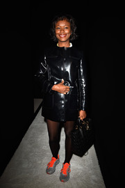 Shala Monroque made an appearance at the Balmain fashion show wearing a shiny black leather coat.