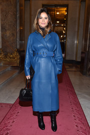 Miroslava Duma arrived for the Balmain show looking chic in a belted blue leather coat.