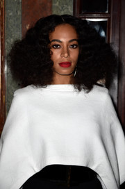 Solange Knowles made an appearance at the Balmain fashion show sporting her signature center-parted curls.