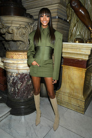 Jourdan Dunn teamed her dress with nude knee-high boots.